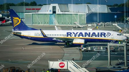 An image taken through the window of the visitor's terrace showing a plane of Irish low cost airline Ryaniar sits at the Hans Koschnick Airport in Bremen, northern Germany, 05 October 2018. Media reports on 01 October 2018 state that Ryanair plans to close its bases in Bremen, Germany, with two planes and in Eindhoven, The Netherlands, with four planes, at the beginning of the winter season 2018/19 on 05 November 2018.