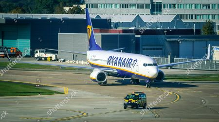 Stock Image of An image taken through the window of the visitor's terrace showing a plane of Irish low cost airline Ryaniar arrives at the Hans Koschnick Airport in Bremen, northern Germany, 05 October 2018. Media reports on 01 October 2018 state that Ryanair plans to close its bases in Bremen, Germany, with two planes and in Eindhoven, The Netherlands, with four planes, at the beginning of the winter season 2018/19 on 05 November 2018.