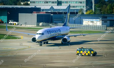 Stock Photo of An image taken through the window of the visitor's terrace showing a plane of Irish low cost airline Ryaniar arrives at the Hans Koschnick Airport in Bremen, northern Germany, 05 October 2018. Media reports on 01 October 2018 state that Ryanair plans to close its bases in Bremen, Germany, with two planes and in Eindhoven, The Netherlands, with four planes, at the beginning of the winter season 2018/19 on 05 November 2018.