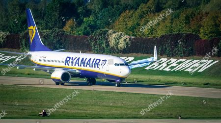 Stock Picture of An image taken through the window of the visitor's terrace showing a plane of Irish low cost airline Ryaniar arrives at the Hans Koschnick Airport in Bremen, northern Germany, 05 October 2018. Media reports on 01 October 2018 state that Ryanair plans to close its bases in Bremen, Germany, with two planes and in Eindhoven, The Netherlands, with four planes, at the beginning of the winter season 2018/19 on 05 November 2018.