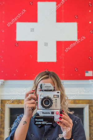 24 hour live performance of Swiss Passport Office by American artist Tom Sachs at Galerie Thaddaeus Ropac London . Visitors can be issued with a Tom Sachs Studio Swiss passport from Friday 5 October, 6pm - Saturday 6 October, 6pm.