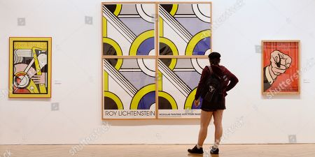 A visitor looks at an artwork by US artist Roy Lichtenstein during the presentation of the exhibition 'Por Art. The Fab Four' at the Pasion Museum in Valladolid, Spain, 05 October 2018. The exhibition running from 05 October to 06 January 2019, features a selection of pieces by Jasper Johns, Robert Rauschenberg, Roy Lichtestein and Andy Warhol.