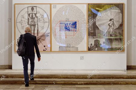 A visitor looks at an artwork by Robert Rauschenberger during the presentation of the exhibition 'Por Art. The Fab Four' at the Pasion Museum in Valladolid, Spain, 05 October 2018. The exhibition running from 05 October to 06 January 2019, features a selection of pieces by Jasper Johns, Robert Rauschenberg, Roy Lichtestein and Andy Warhol.