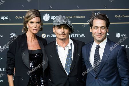 American actor Johnny Depp (C) poses next to co-director Nadja Schildknecht (L) and Zurich Film director Karl Spoerri on the Green Carpet prior to the screening of the movie 'Richard says goodbye' during the 14th Zurich Film Festival (ZFF) in Zurich, Switzerland, 05 October 2018. The festival runs from 27 September to 07 October.