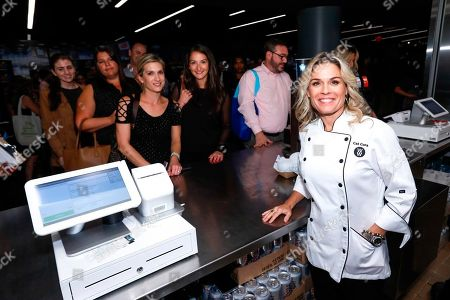 Celebrity Chef and newest WW Ambassador Cat Cora, right, opens the WW Freestyle Café: BKLYN at Barclays Center on in Brooklyn, New York. The WW Freestyle Café: BKLYN offers a diverse menu of WW Freestyle-inspired Mediterranean dishes