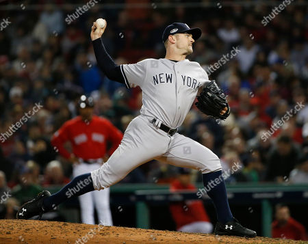 New York Yankees relief pitcher David Robertson throws to a Boston Red Sox batter during the eighth inning of Game 1 of a baseball American League Division Series, in Boston