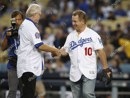 Former Los Angeles Dodgers player Bill Russell (L) shakes hands with former Los Angeles Dodgers player Ron Cey (R) after throwing out the ceremonial first pitch before game two of the MLB National League Division Series playoffs between the Atlanta Braves and Los Angeles Dodgers at Dodgers Stadium in Los Angeles, California, USA, 05 October 2018. The winner of the best of five game series will advance to the National League Championship Series.