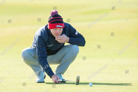 Stephen Gallacher lines up a putt on the first green, during the third round of the Alfred Dunhill Links Championships 2018 at St Andrews, West Sands