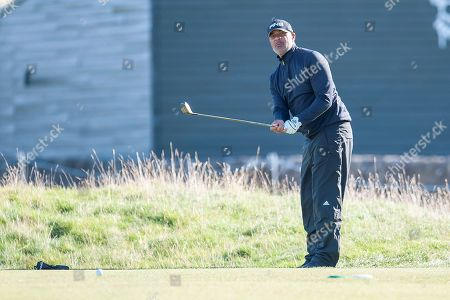 Ruud Gullit chips to the 16th green during the Alfred Dunhill Links Championships 2018 at St Andrews, West Sands
