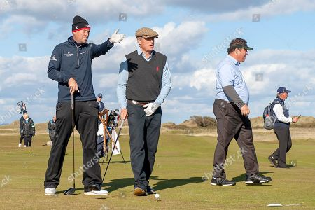 David Howell (left) tells actor Hugh Grant the best line during the Alfred Dunhill Links Championships 2018 at St Andrews, West Sands