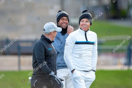 Ryan Smith (in white) joint founder of Qualtrics, a software research company, shares a joke with Paul McGinley and Tony Finau, during the Alfred Dunhill Links Championships 2018 at St Andrews, West Sands