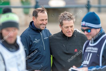 David Howell (left) and Hugh Grant pose for a picture on the first tee, before the third round of the Alfred Dunhill Links Championships 2018 at St Andrews, West Sands