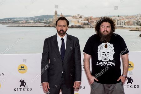 US actor and cast-member Nicolas Cage (L) and Italian-Canadian film director Panos Cosmatos pose for photographers upon his arrival to present their film 'Mandy' as part of the Sitges Fantastic Film Festival, in Sitges, Barcelona, northeastern Spain, 06 October 2018. The film competes in the official section of the festival running from 04 to 14 October 208. Cage is to receive Honorary Lifetime Achievement Award of the festival.