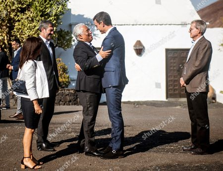 Spanish Prime Minister, Pedro Sanchez (C-R), hugs his Portuguese counterpart, Antonio Costa (C-L), as they visit Cesar Manrique Foundation in Lanzarote island, Canary Islands, Spain, 06 October 2018. Sanchez and Costa are on the island to mark the 20th anniversary of the award of Literature Nobel Prize to late Portuguese writer Jose Saramago. Saramago spent his last years in the Spanish island.