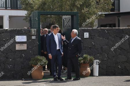 Spanish Prime Minister, Pedro Sanchez (C-L), chats with his Portuguese counterpart, Antonio Costa (C-R), as they leave after attending an event to mark the 20th anniversary of the award of Literature Nobel Prize to late Portuguese writer Jose Saramago in the town of Tias, in Lanzarote island, Canary Islands, Spain, 06 October 2018. Saramago spent his last years in the Spanish island.