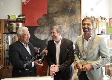 Portuguese Prime Minister, Antonio Costa (L), receives a present by Canary Islands' Regional President, Fernando Clavijo (C) and Lanzarote's Provincial head, Pedro San Gines (R) after an event to mark the 20th anniversary of the award of Literature Nobel Prize to late Portuguese writer Jose Saramago at Saramago's house in the town of Tias, in Lanzarote island, Canary Islands, Spain, 06 October 2018. Saramago spent his last years in the Spanish island.