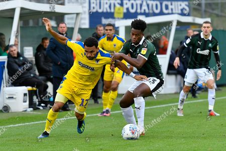 Andy Barcham (17) of AFC Wimbledon battles for possession with Ashley Smith-Brown (23) of Plymouth Argyle during the EFL Sky Bet League 1 match between Plymouth Argyle and AFC Wimbledon at Home Park, Plymouth