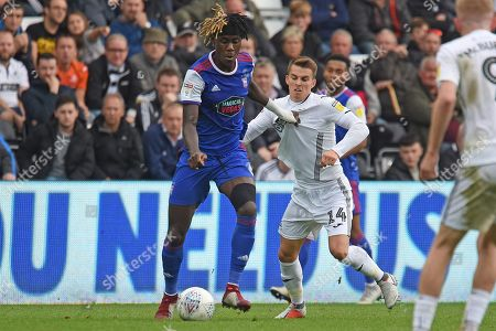 Ipswich Town defender Trevoh Chalobah (6) on loan from Chesea, battles with Swansea City midfielder Tom Carroll (14) during the EFL Sky Bet Championship match between Swansea City and Ipswich Town at the Liberty Stadium, Swansea
