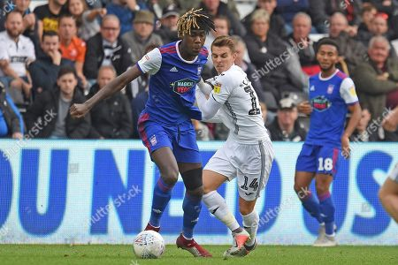 pswich Town defender Trevoh Chalobah (6) on loan from Chesea, battles with Swansea City midfielder Tom Carroll (14) during the EFL Sky Bet Championship match between Swansea City and Ipswich Town at the Liberty Stadium, Swansea