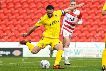 Craig Morgan of Fleetwood Town (20) clears the ball during the EFL Sky Bet League 1 match between Doncaster Rovers and Fleetwood Town at the Keepmoat Stadium, Doncaster