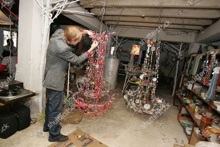 Designer Sean Daniel adds a few finishing touches to a chandelier