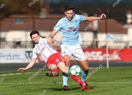 Stock Picture of Ballymena vs Newry City. Ballymena's Adam Lecky in action with Darren. King of Newry City