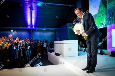 Dutch D66 leader Alexander Pechtold holds flowers after speaking to delegates during a party congress in s-Hertogenbosch, The Netherlands, 06 October 2018. He announced that he quits as head of the party and will leave as an MP on 09 October 2018.