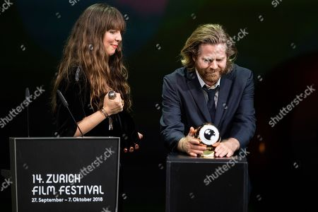 Janus Metz (R) and Sine Plambech receive the Golden Eye award for the movie 'Heardbound' during the Award Night ceremony at the 14th Zurich Film Festival (ZFF), in Zurich, Switzerland, 06 October 2018. The festival runs from 27 September to 07 October.