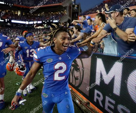 Florida defensive back Brad Stewart Jr. (2) celebrates with fan after defeating LSU in an NCAA college football game, in Gainesville, Fla. Stewart intercepted an LSU pass in the final minutes of the game to help seal the win for Florida