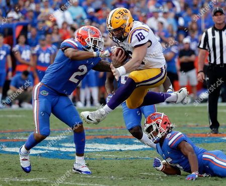 Foster Moreau, Brad Stewart Jr., CJ Henderson. LSU tight end Foster Moreau (18) leaps between Florida defensive back Brad Stewart Jr. (2) and defensive back CJ Henderson, lower right, after a reception during the second half of an NCAA college football game, in Gainesville, Fla