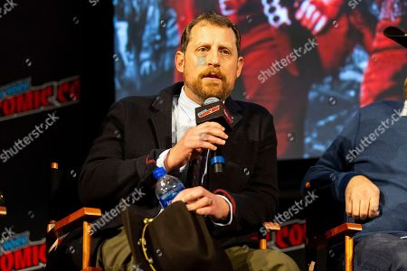 "Scott M. Gimple speaks on stage at ""The Walking Dead"" panel on the third day of New York Comic Con"