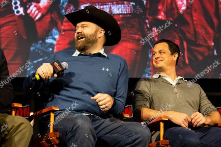 "Robert Kirkman, left, laughs on stage while Dave Alpert looks on at ""The Walking Dead"" panel on the third day of New York Comic Con"
