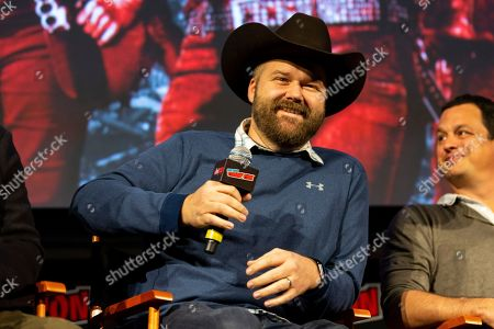 "Robert Kirkman smiles on stage at ""The Walking Dead"" panel on the third day of New York Comic Con"