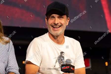 """Andrew Lincoln laughs on stage at """"The Walking Dead"""" panel on the third day of New York Comic Con"""