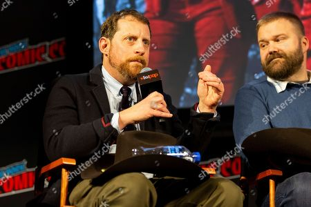 "Scott M. Gimple, left, speaks on stage at ""The Walking Dead"" panel on the third day of New York Comic Con"