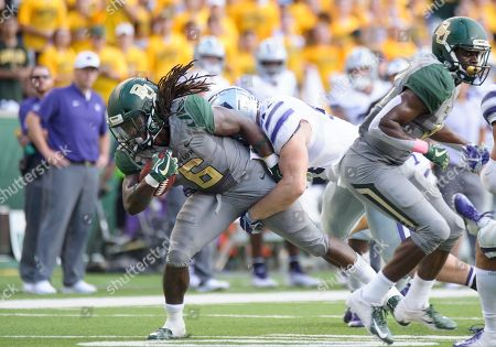 Kansas State Wildcats defensive end Kyle Alan Ball (44) tackles Baylor Bears running back JaMycal Hasty (6) during the 2nd half of the NCAA Football game between the Kansas State Wildcats and the Baylor Bears at McLane Stadium in Waco, Texas