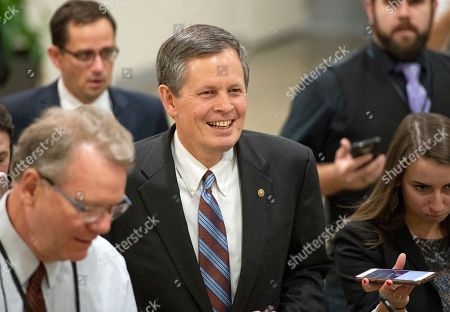 Stock Picture of United States Senator Steve Daines (Republican of Montana) is surrounded by reporters in the US Senate Subway in the US Capitol.