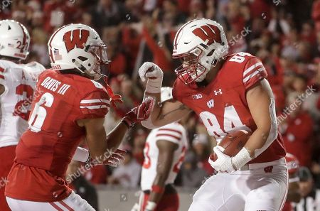 Wisconsin's Jake Ferguson celebrates his touchdown catch with Danny Davis III during the first half of an NCAA college football game against Nebraska, in Madison, Wis