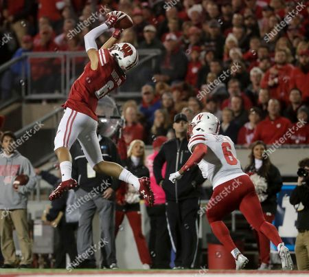 Wisconsin's Danny Davis III catches a pass in front of Nebraska's Eric Lee Jr. during the first half of an NCAA college football game, in Madison, Wis