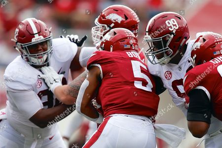 Stock Picture of Raekwon Davis #99 Alabama defensive tackle works to bring down Arkansas running back Rakeem Boyd #5. Alabama defeated Arkansas 65-31 at Donald W. Reynolds Stadium in Fayetteville, AR, Richey Miller/CSM