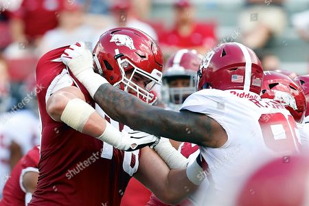 Arkansas offensive lineman Dalton Wagner #78 works against Alabama defensive lineman Raekwon Davis #99. Alabama defeated Arkansas 65-31 at Donald W. Reynolds Stadium in Fayetteville, AR, Richey Miller/CSM