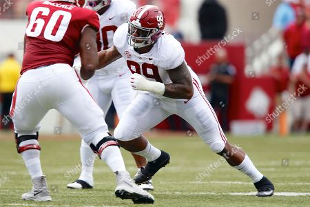Raekwon Davis #99 Tide defensive lineman works his way up the field. Alabama defeated Arkansas 65-31 at Donald W. Reynolds Stadium in Fayetteville, AR, Richey Miller/CSM