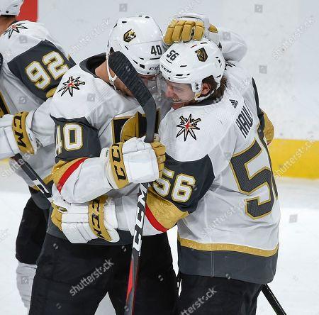 Vegas Golden Knights left wing Erik Haula (56) celebrates with center Ryan Carpenter (40) after scoring an NHL hockey game winning goal in a shootout, in St. Paul, Minn
