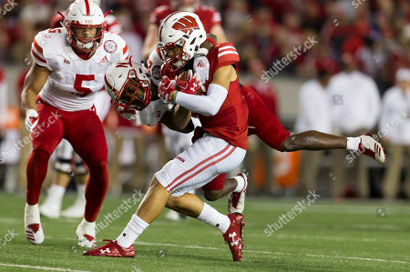 Wisconsin Badgers wide receiver Danny Davis III #6 is tackled after the catch during the NCAA Football game between the Nebraska Cornhuskers and the Wisconsin Badgers at Camp Randall Stadium in Madison, WI. Wisconsin defeated Nebraska 41-24