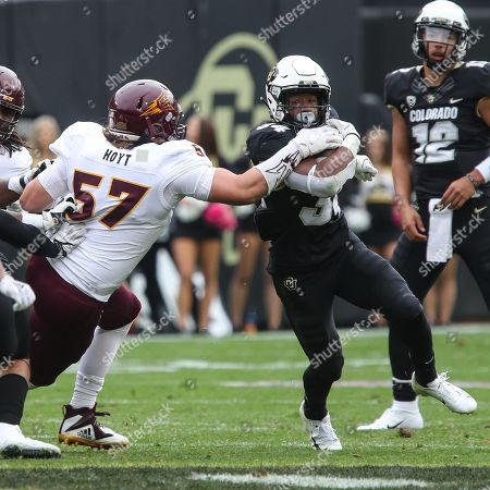 Colorado's running back Travon McMillian tries to break free of Arizona State's Jordan Hoyt during the second half in Boulder. The Buffs won 28-21 at home to improve to 5-0