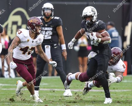 Colorado's running back Travon McMillian tries to break free of Arizona State's Merlin Robertson during the second half in Boulder. The Buffs won 28-21 at home to improve to 5-0