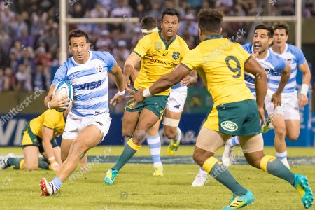 Will Genia (R) of Australia in action against Santiago Gonzalez Iglesias (L) of Argentina during the 2018 Rugby Championship game between the Pumas of Argentina and the Wallabies of Australia at the Ernesto Martearena Stadium in Salta, Argentina, 06 October 2018.