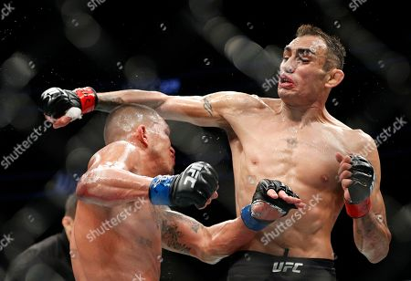 Tony Ferguson, right, fights Anthony Pettis during a lightweight mixed martial arts bout mixed martial arts bout at UFC 229 in Las Vegas, . Ferguson won by technical knockout during the second round