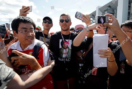 German soccer player Lukas Podolski (C) is surrounded by Formula One fans before the Japanese Formula One Grand Prix at the Suzuka Circuit in Suzuka, central Japan, 07 October 2018.