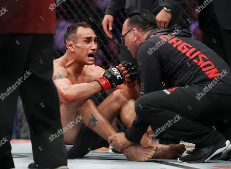 Tony Ferguson celebrates after fighting Anthony Pettis during a lightweight mixed martial arts bout mixed martial arts bout at UFC 229 in Las Vegas, . Ferguson won by technical knockout during the second round
